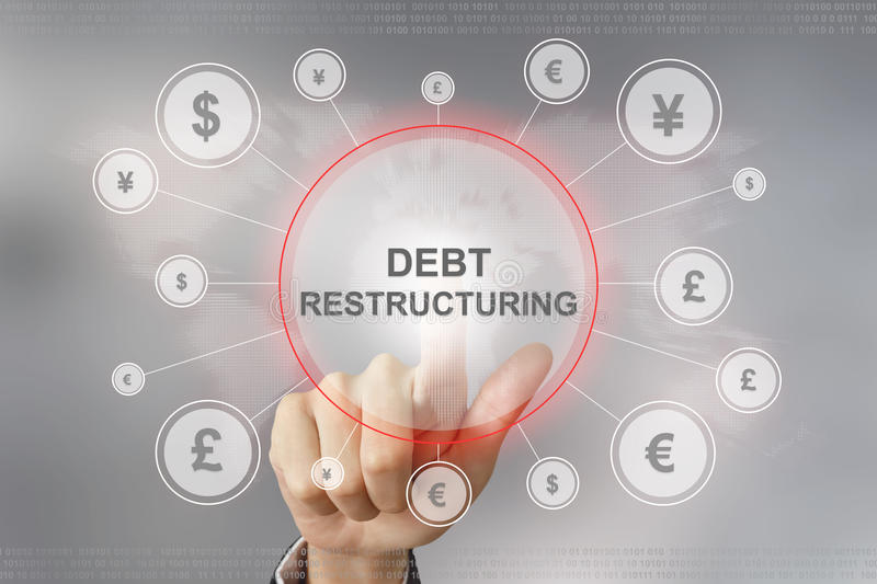 Business hand pushing debt restructuring button. Hand pushing debt restructuring button with global networking concept royalty free stock image