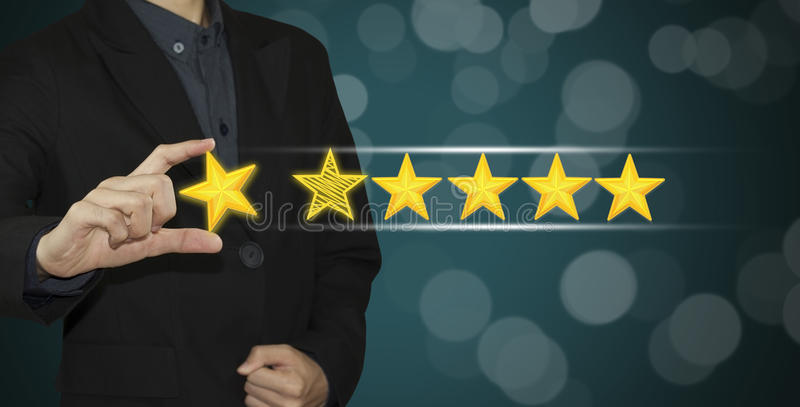 Business hand select yellow marker on five star rating. royalty free stock images