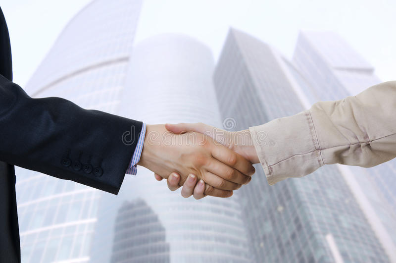 Business hand shake between two colleagues stock photos
