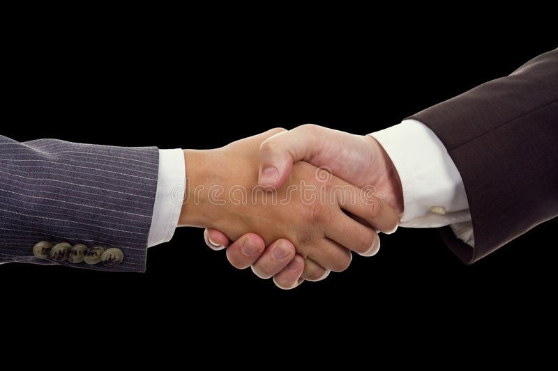 Business Hand shaking. On a black background stock photo