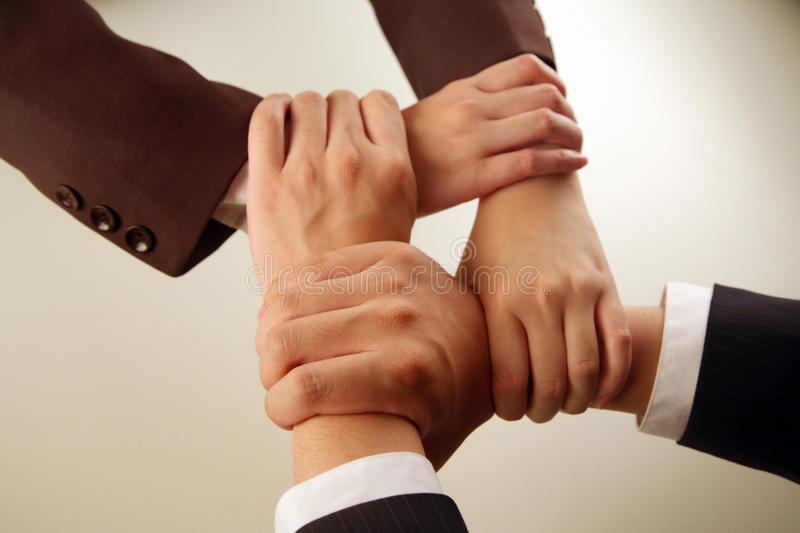 Business hands linked stock photography