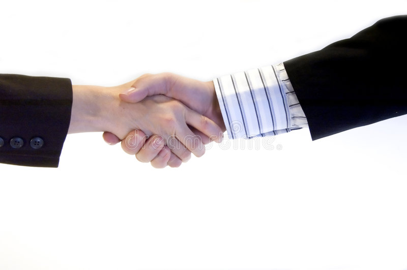 Business handshake. A business woman shaking hands with a collegue stock images