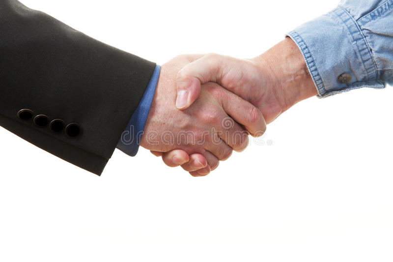 Business handshake. Closeup of a handshake on a white background