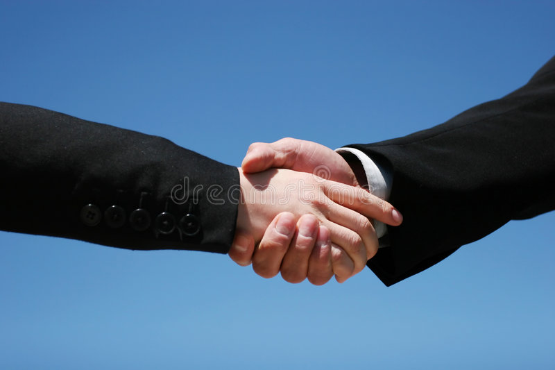 Business handshake. Young girl and guy handshaking for business royalty free stock image