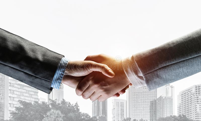 Business handshake as idea for unity and cooperation or greeting stock photos