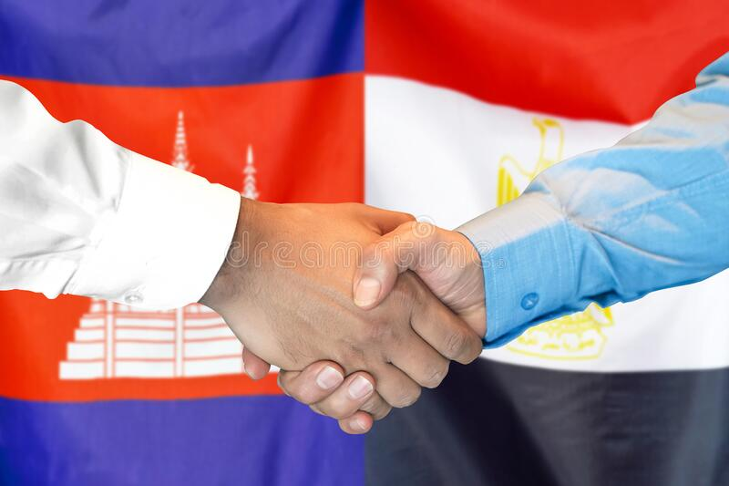 Handshake on Cambodia and Egypt flag background. Support concept. Business handshake on the background of two flags. Men handshake on the background of the royalty free stock photography