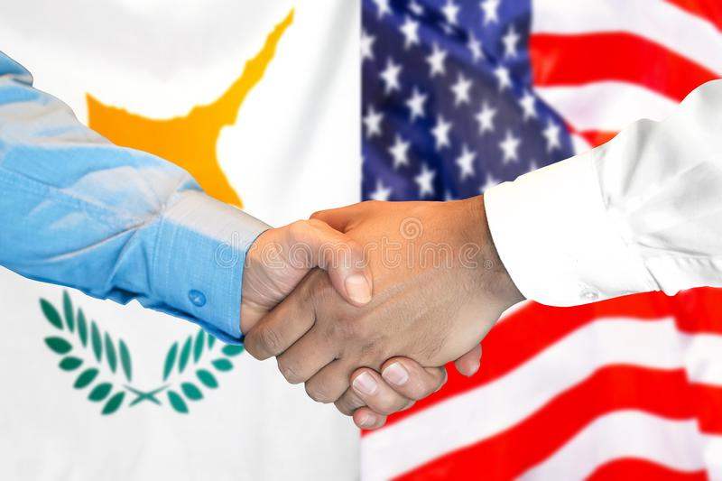 Handshake on Cyprus and US flag background. Business handshake on the background of two flags. Men handshake on the background of the Cyprus and United States of royalty free stock photo