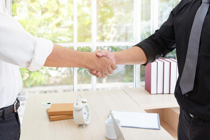 Business handshake. Business associate shaking hands in office. Bangkok Thailand royalty free stock photography