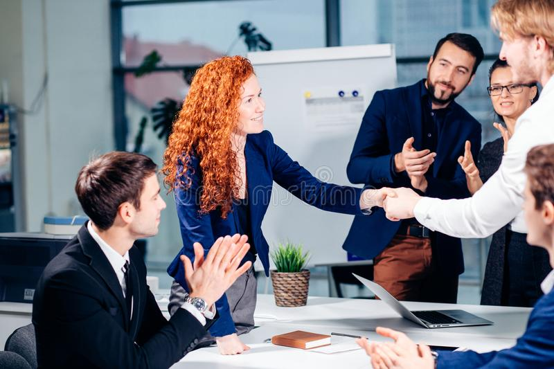 Business handshake. Business handshake and business people concept stock images