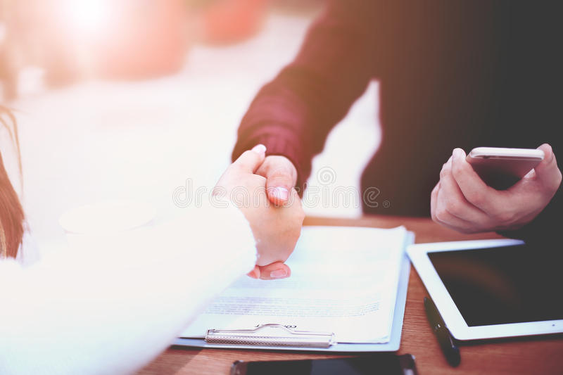 Business handshake and business people.Vintage tone royalty free stock image
