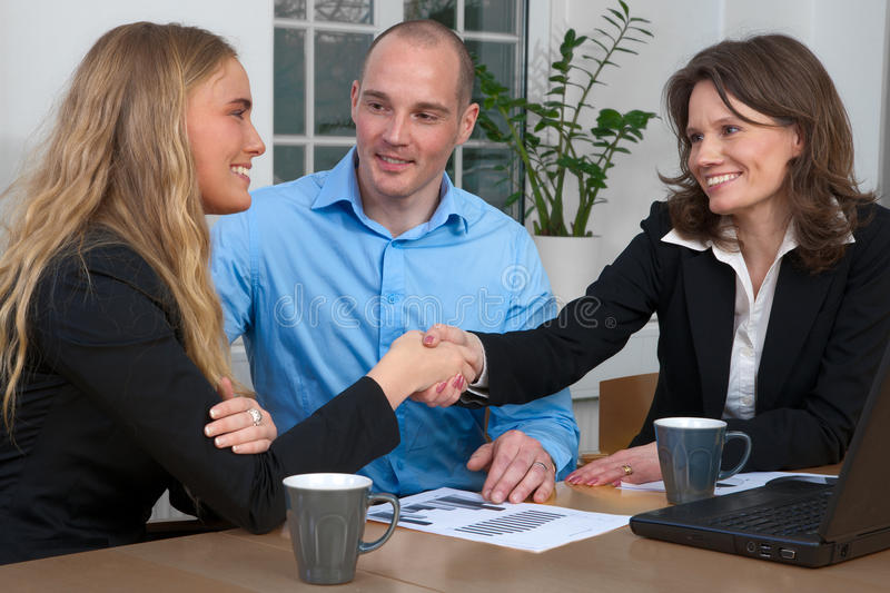 Business handshake among caucasian group stock images
