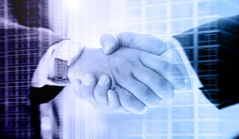 Business handshake on a city background royalty free stock images