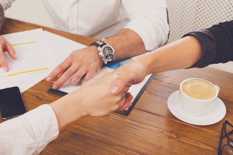 Business handshake closeup at office meeting, contract conclusion royalty free stock images