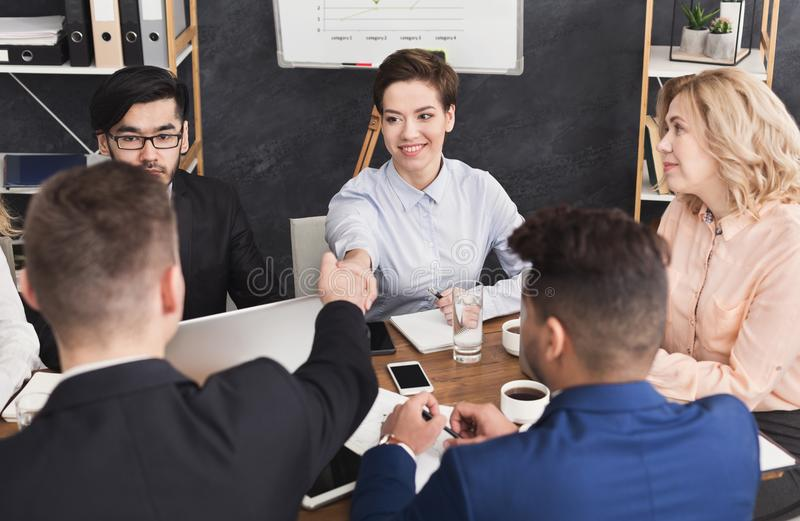 Business handshake after discussing good deal. Business handshake and business people after discussing good deal of trading contract and new projects for both stock image