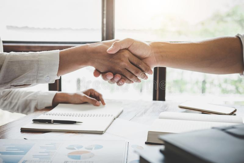 Business handshake after discussing good deal of Trading to sign. Agreement and become a business partner, contract for both companies, Successful businessman stock image