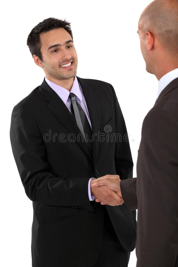 A business handshake. Is a good way to say hello stock photography