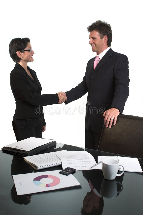 Business handshake - isolated. Young business people are shaking hands after a business deal. Isolated version stock image