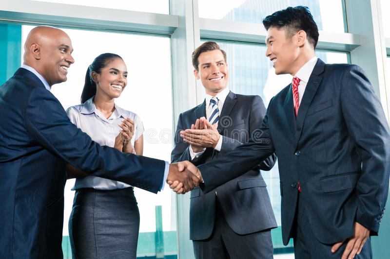Business handshake in lofty office with city view. A deal is struck royalty free stock photos