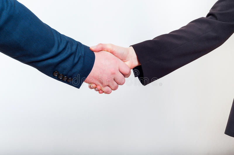 Business handshake when making a good profitable deal. On a white background stock photos