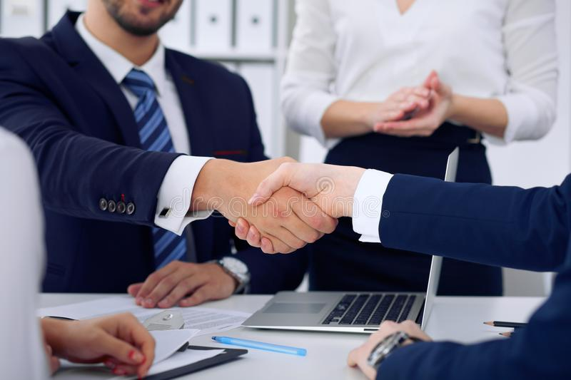 Business handshake at meeting or negotiation in the office, close-up. Partners are satisfied because signing contract or royalty free stock images
