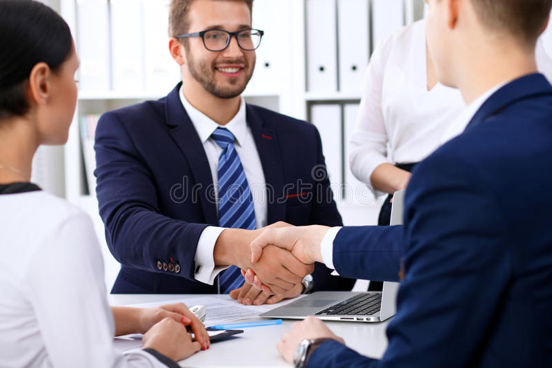 Business handshake at meeting or negotiation in the office. Partners are satisfied because signing contract or financial royalty free stock photo