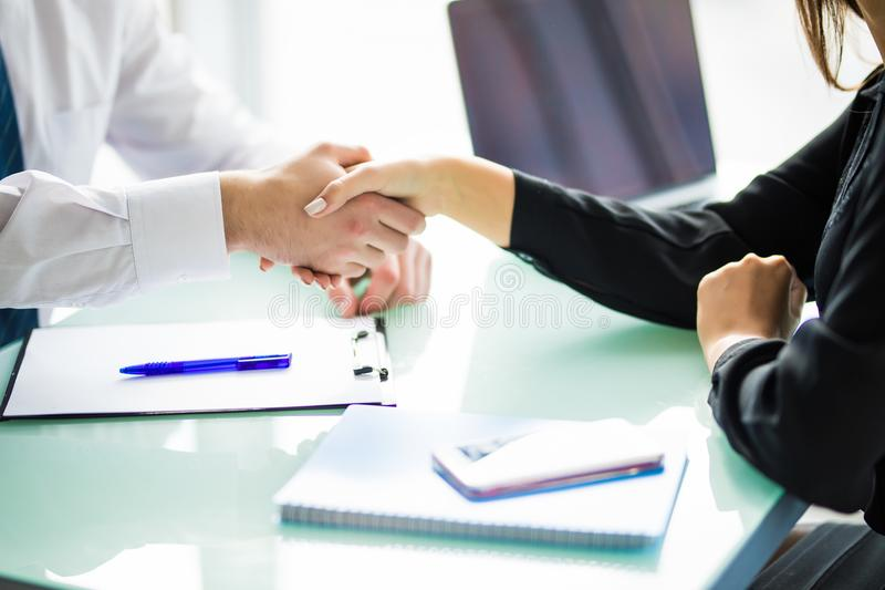 Business handshake at meeting or negotiation in the office. Partners are satisfied because signing contract or financial papers. B stock photos