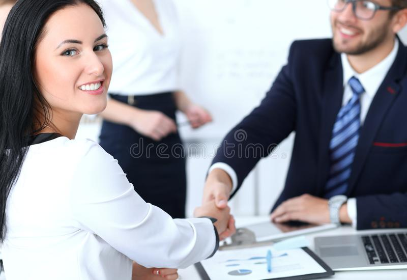 Business handshake at meeting or negotiation in the office. Two businesspeople partners are satisfied because signing royalty free stock image