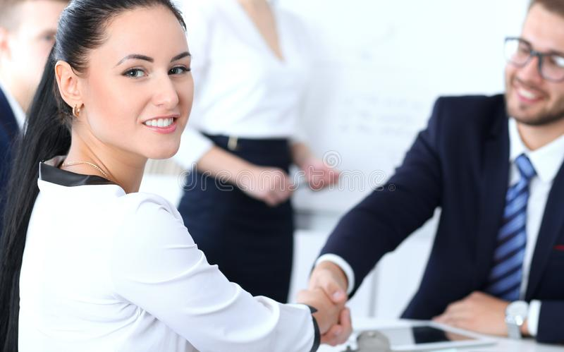 Business handshake at meeting or negotiation in the office. Two businesspeople partners are satisfied because signing stock image
