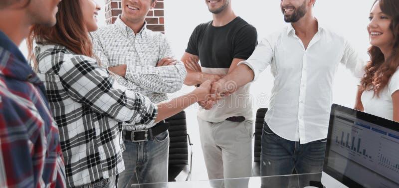 Business handshake in modern office stock image