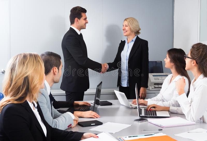 Business handshake at negotiations. At meeting room royalty free stock images