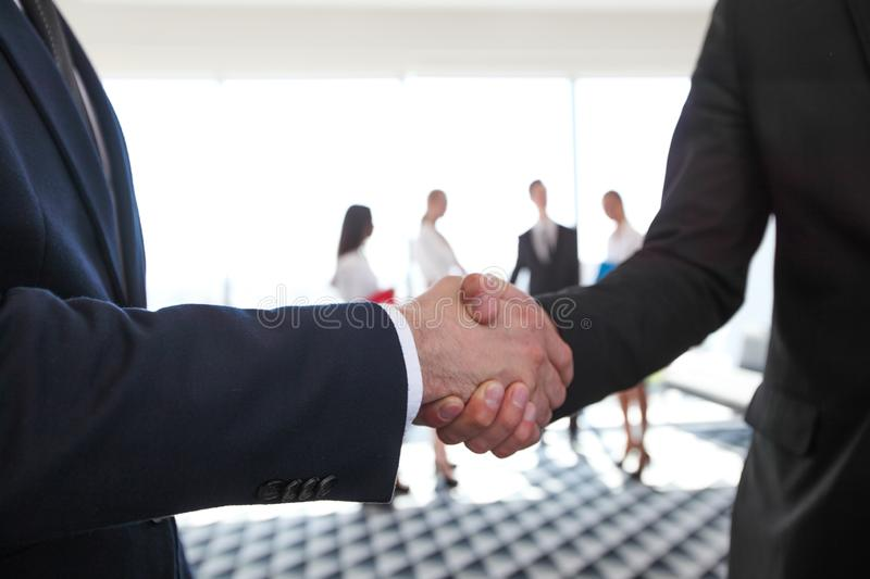 Business handshake in office stock photo