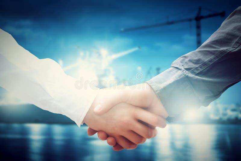 Business handshake in shipyard. Industry contract stock photo