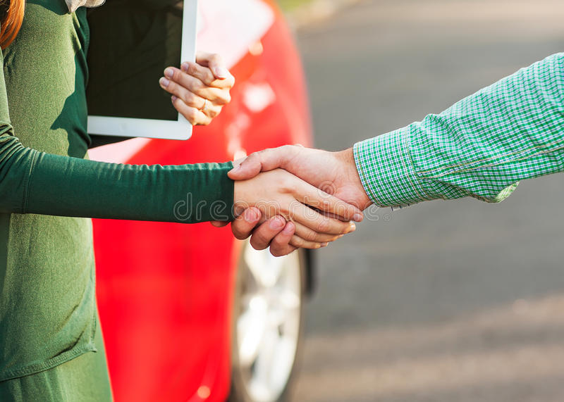Business handshake to close the deal after buying a car royalty free stock image