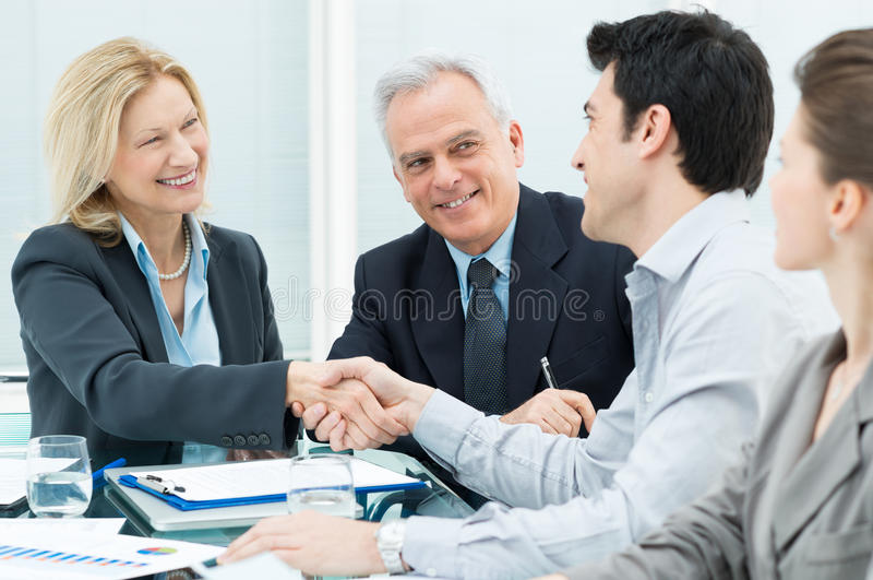 Business Handshake to Seal a Deal. Successful Business Executives Shaking Hands With Each Other royalty free stock photography