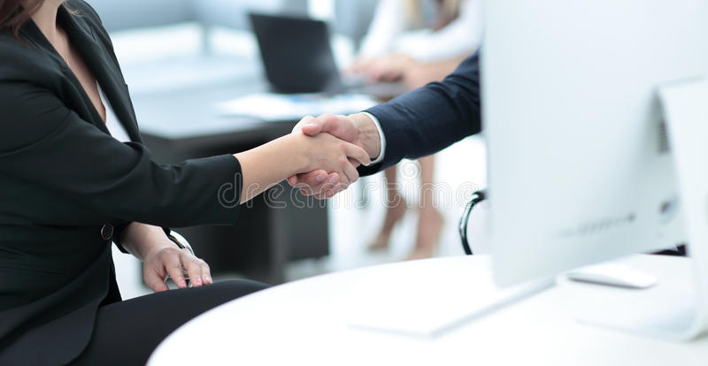 Business handshake. Two business people shaking hands in office. stock photography
