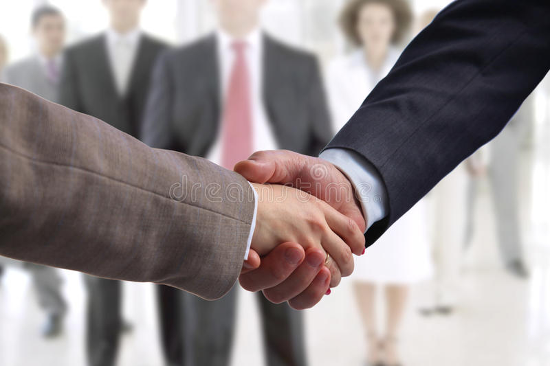 Business handshake. Two businessman shaking hands. With each other in the office stock photo