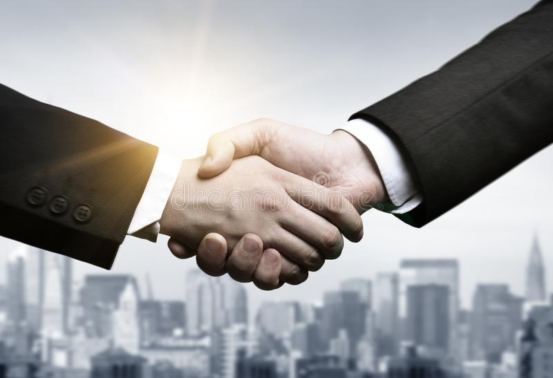 Business handshake vintage tone stock photography