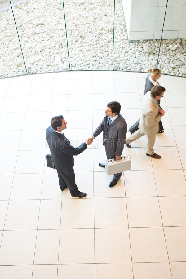 Business handshakes. Business people shaking hands in workplace stock image