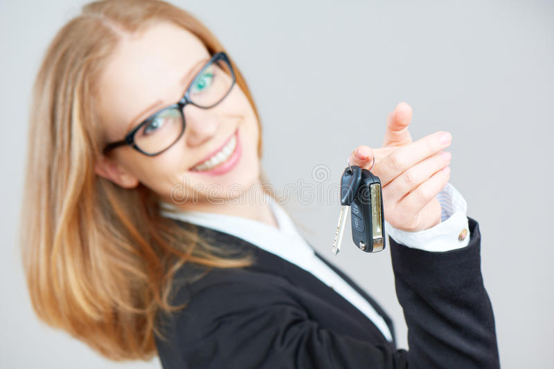 Business happy woman holding car keys. The business happy woman holding car keys stock photos