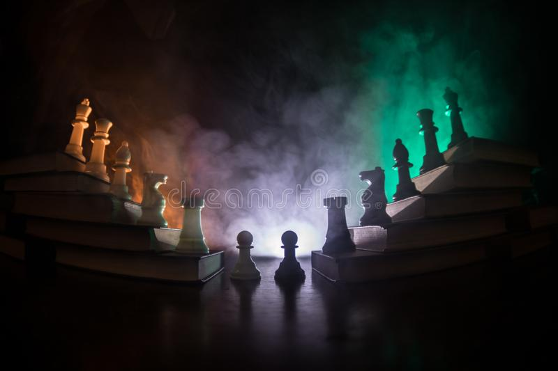 Business hierarchy. Strategy concept with chess pieces. Chess standing on a pyramid of wooden building blocks with the king at the. Business hierarchy. Strategy royalty free stock photography