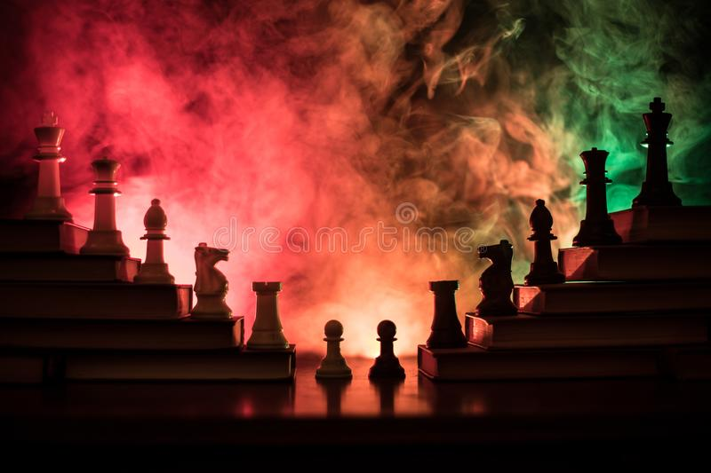 Business hierarchy. Strategy concept with chess pieces. Chess standing on a pyramid of wooden building blocks with the king at the. Business hierarchy. Strategy stock image