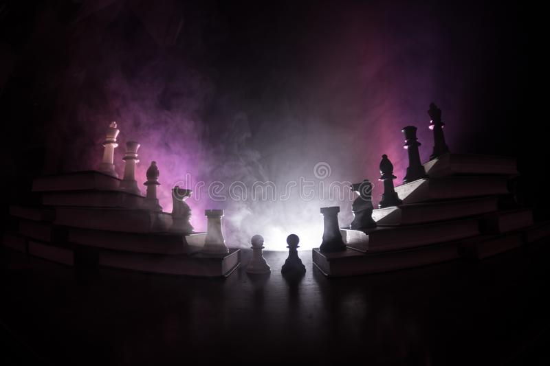 Business hierarchy. Strategy concept with chess pieces. Chess standing on a pyramid of wooden building blocks with the king at the. Business hierarchy. Strategy stock photography
