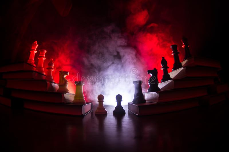 Business hierarchy. Strategy concept with chess pieces. Chess standing on a pyramid of wooden building blocks with the king at the. Business hierarchy. Strategy royalty free stock photos