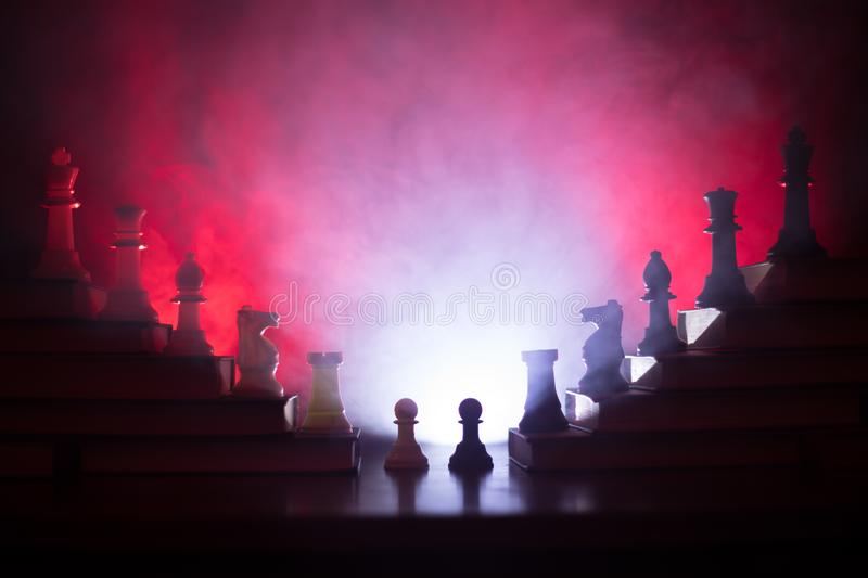 Business hierarchy. Strategy concept with chess pieces. Chess standing on a pyramid of wooden building blocks with the king at the. Business hierarchy. Strategy stock photos