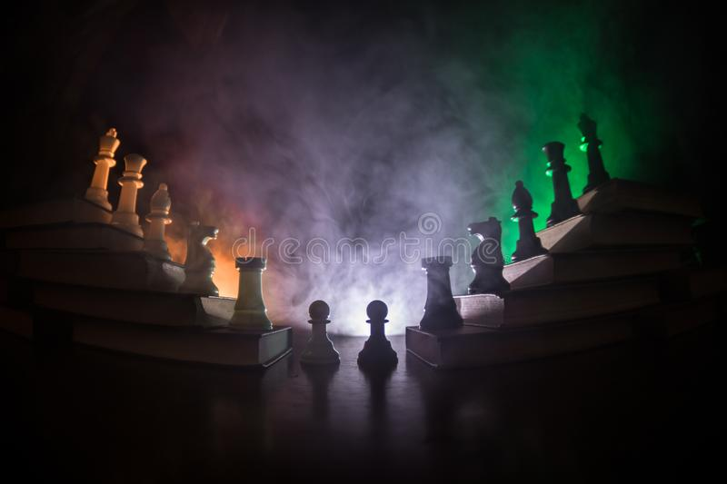 Business hierarchy. Strategy concept with chess pieces. Chess standing on a pyramid of wooden building blocks with the king at the. Business hierarchy. Strategy royalty free stock images