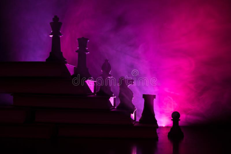 Business hierarchy. Strategy concept with chess pieces. Chess standing on a pyramid of wooden building blocks with the king at the. Business hierarchy. Strategy royalty free stock image