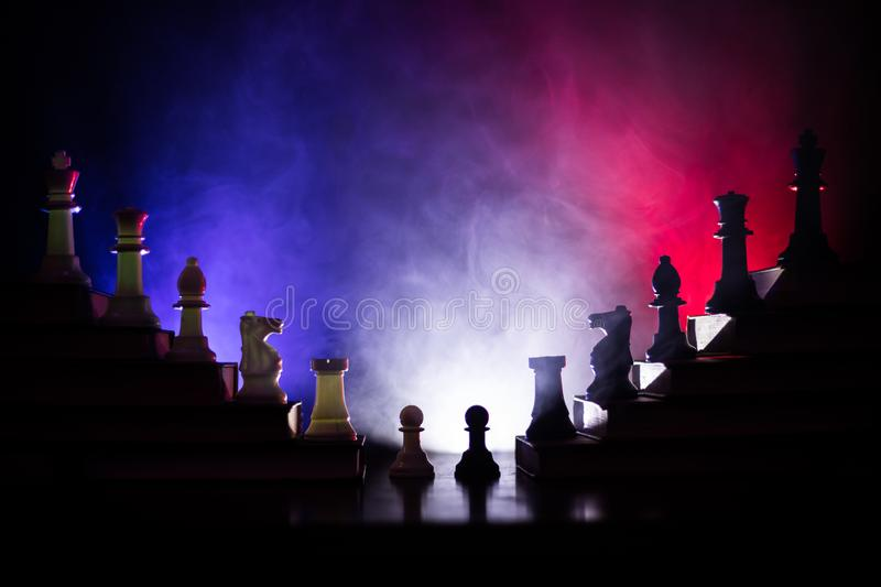 Business hierarchy. Strategy concept with chess pieces. Chess standing on a pyramid of wooden building blocks with the king at the. Business hierarchy. Strategy stock images