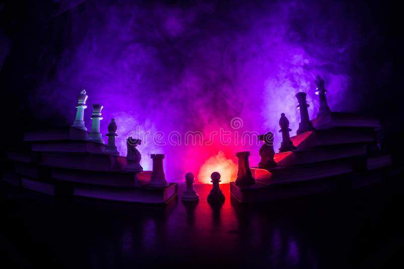 Business hierarchy. Strategy concept with chess pieces. Chess standing on a pyramid of wooden building blocks with the king at the. Business hierarchy. Strategy royalty free stock photo