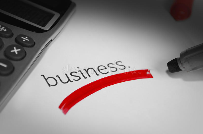 Business highlighted. Business word marked on red and calculator stock images