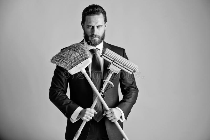 Business and home, fashion, handsome man or businessman with broom royalty free stock photo